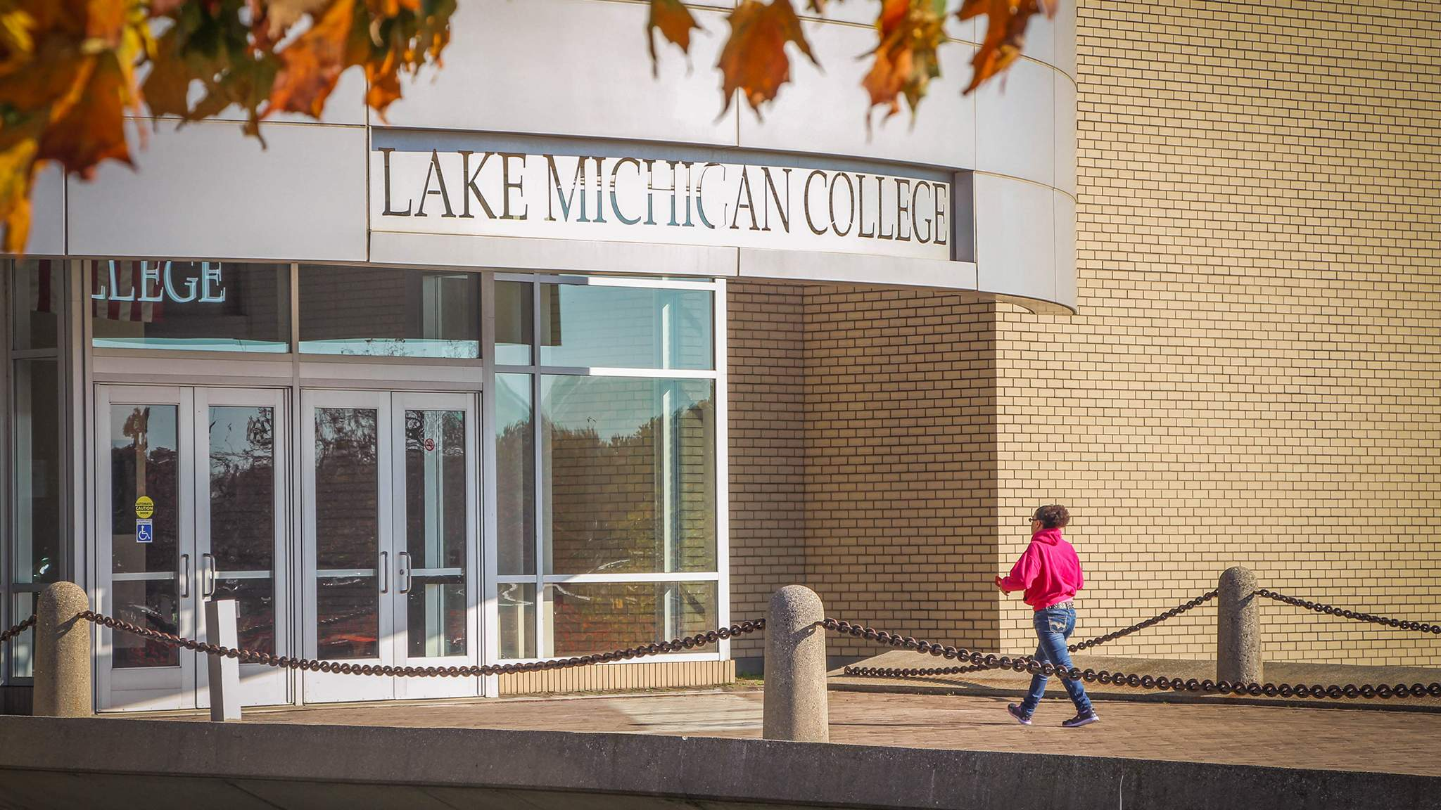 Student walking into LMC Benton Harbor Campus Building