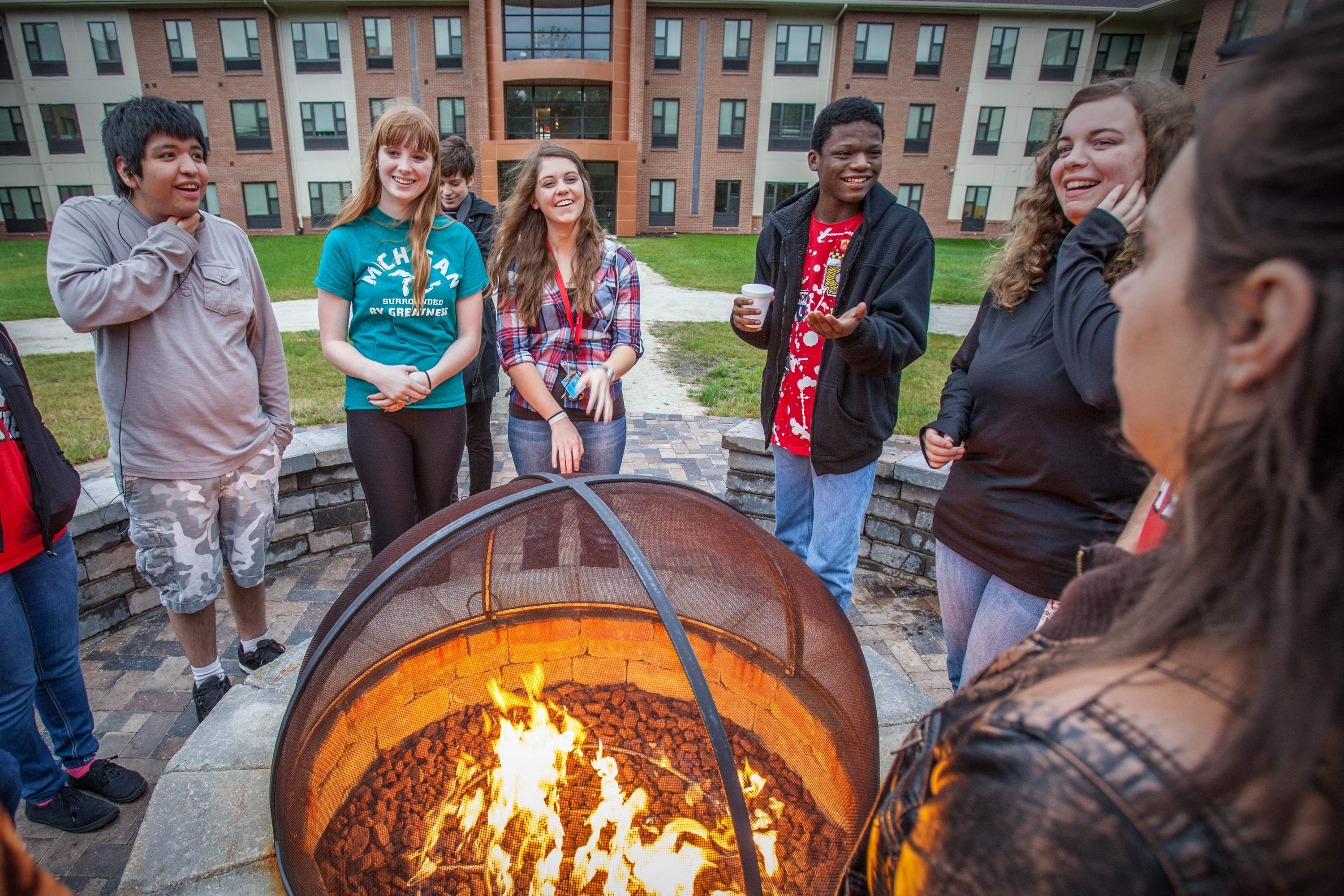 Students around campfire out of Beckwith Hall