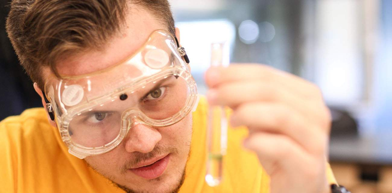 Student working in a science lab at Lake Michigan College
