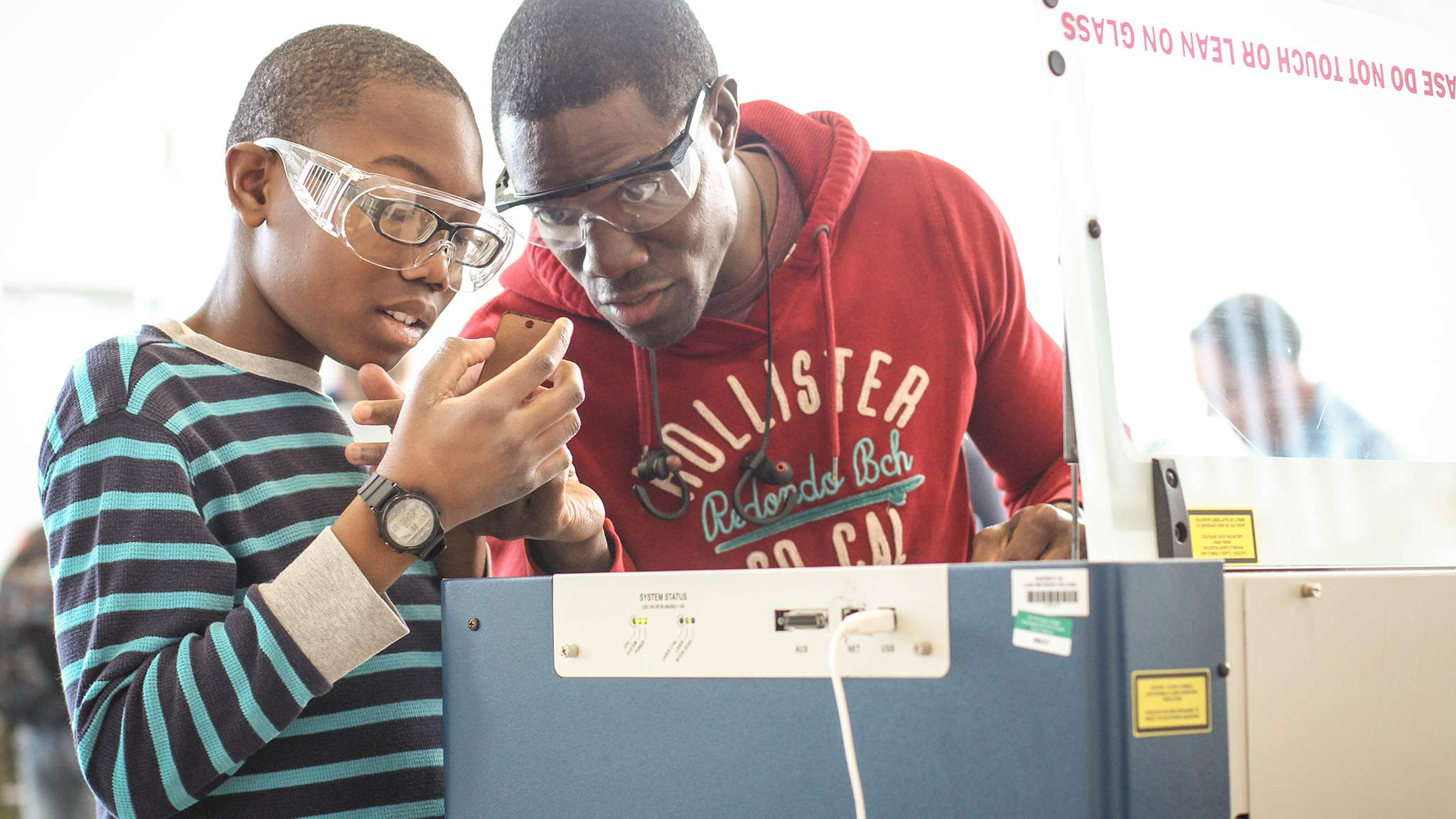 Father and son working together in LMC Fab Lab