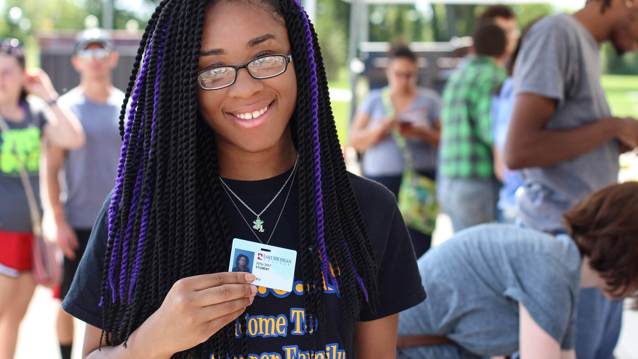 Student with student ID badge