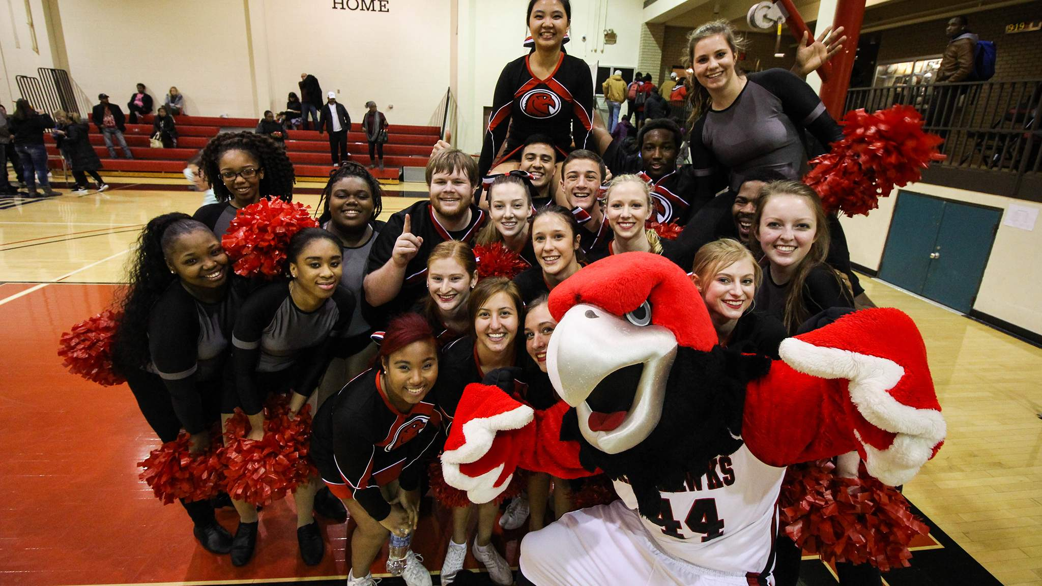 Cheer Club and Rocky at Basketball Game