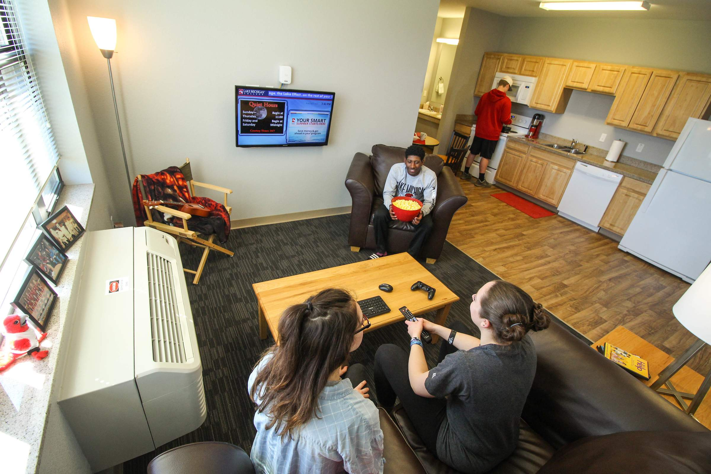 Students in shared living spaces in a dorm suite