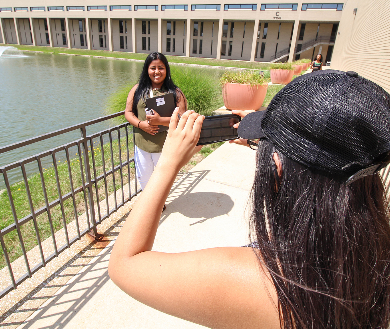 Student taking a picture at LMC campus