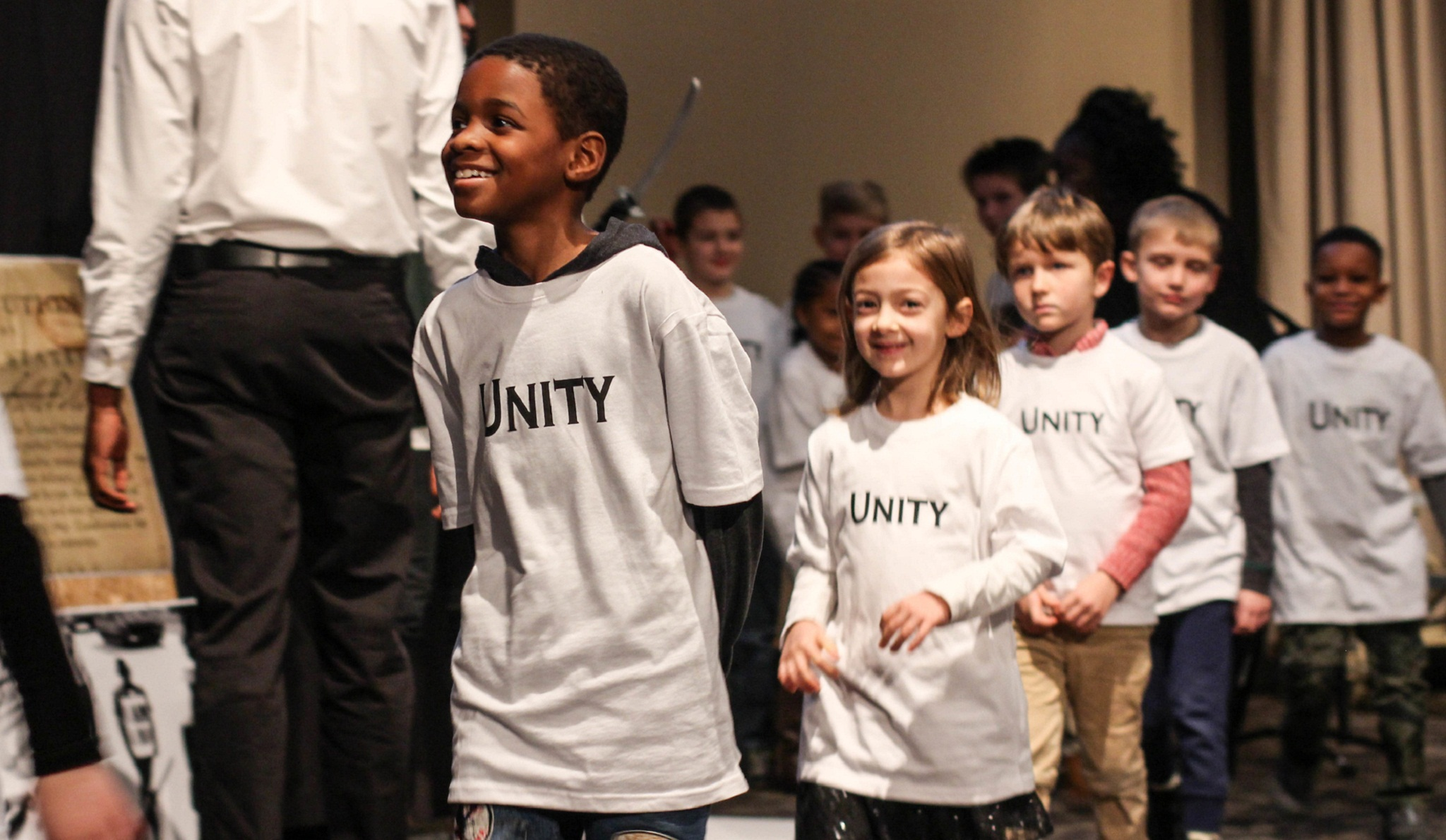 five children in a line wearing Unity tee shirts