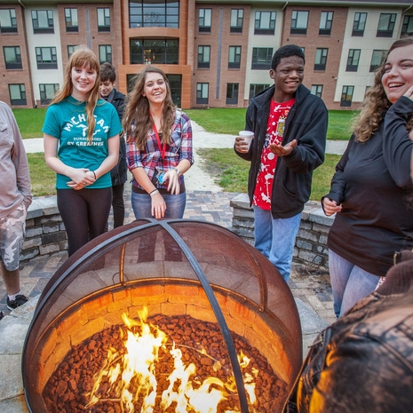 LMC Students around campfire at Beckwith Hall