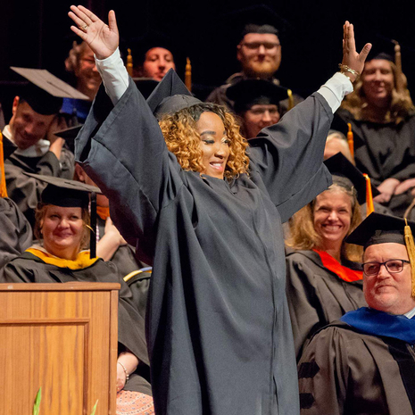 Graduate celebrates at commencement. Link to transfer page.