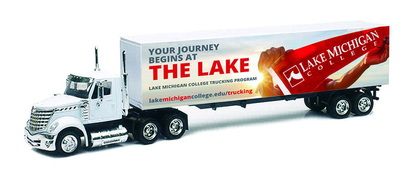 Semi truck with Lake Michigan College graphic wrapped around trailer.