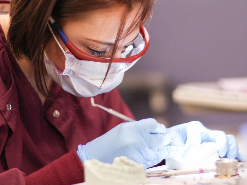 Dental Assistant cleaning a patient's teeth