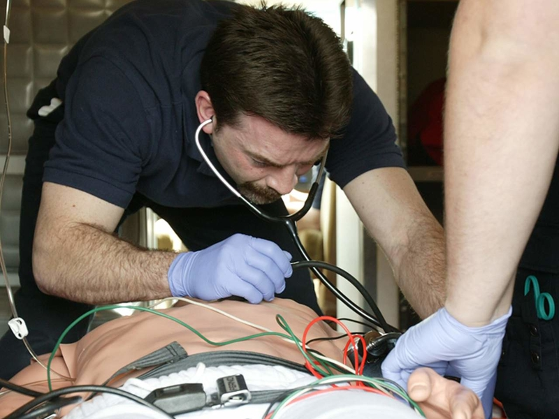 EMT student practicing on a simulation model