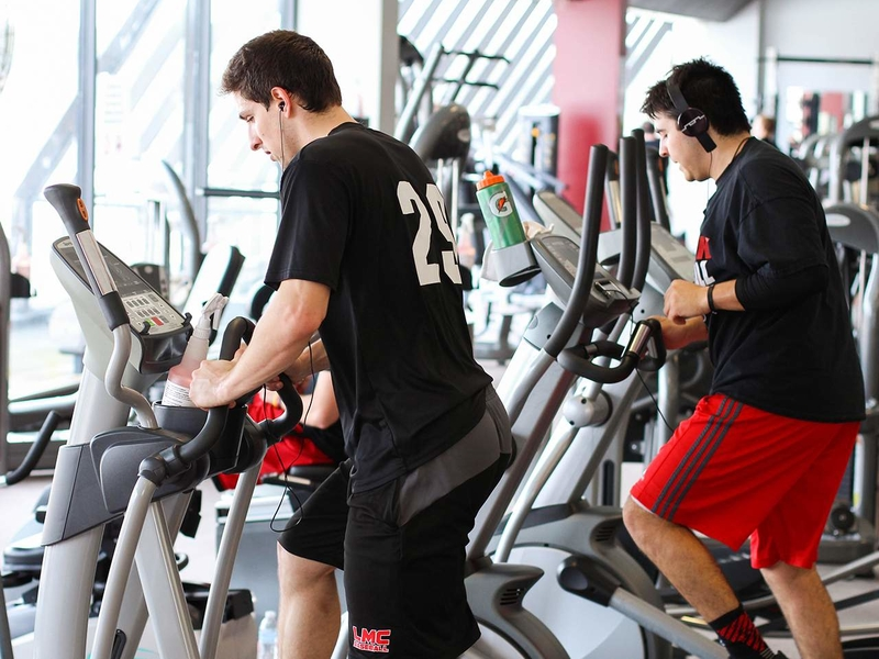 Students working out on a Stairmaster in Wellness Center