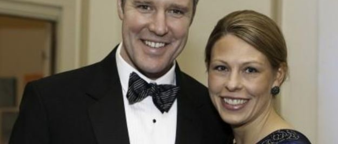 Photo of John and Kristi Proos in formal attire