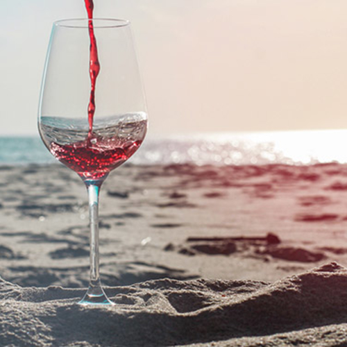 Wine glass on the beach